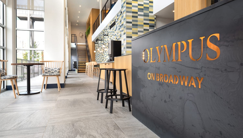 Reception desk at Olympus on Broadway in Carrollton, TX