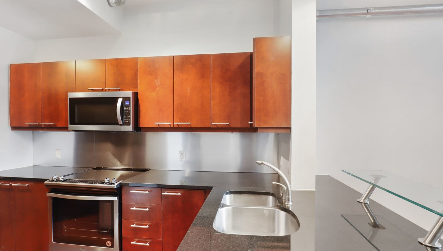 Kitchen with plenty of cabinet space at 17th Street Lofts in Atlanta, Georgia