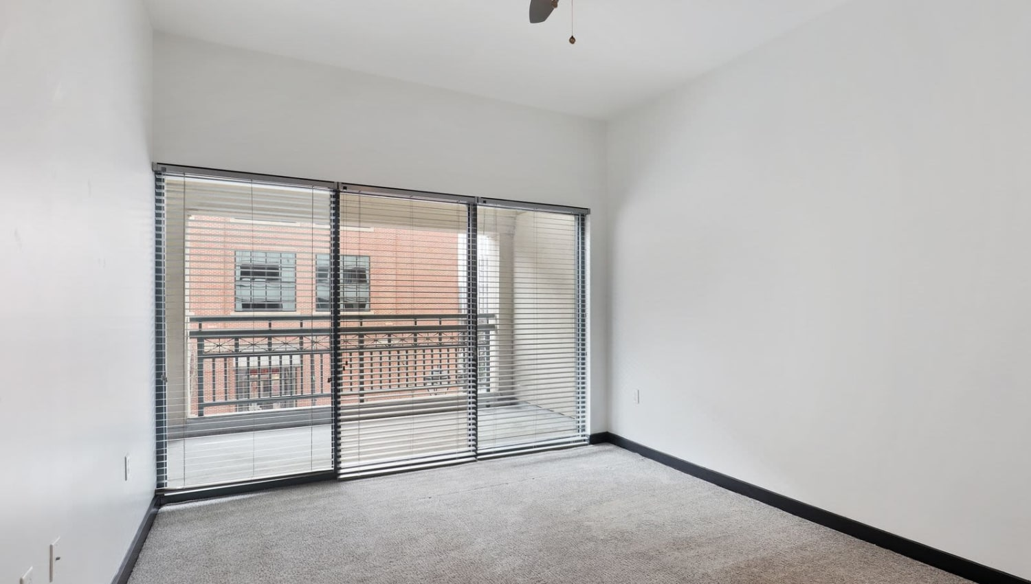 Bright bedroom with large floor to ceiling windows at 17th Street Lofts in Atlanta, Georgia