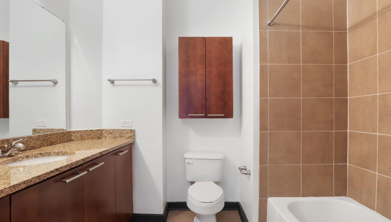 Bathroom with tile floor and tile shower/bath walls at 17th Street Lofts in Atlanta, Georgia