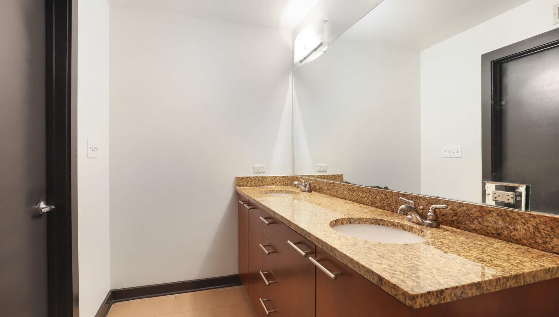 Spacious bathroom with large mirror at 17th Street Lofts in Atlanta, Georgia
