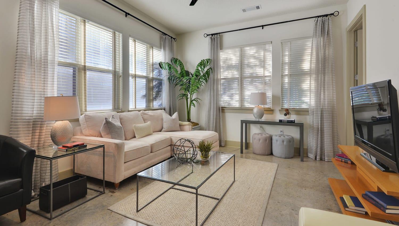 Bright, spacious living room at Optimist Lofts in Atlanta, Georgia