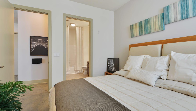 Bedroom with a walk-in closet at Optimist Lofts in Atlanta, Georgia