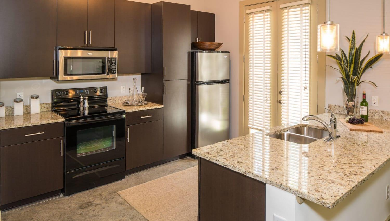Kitchen with granite counters at Optimist Lofts in Atlanta, Georgia