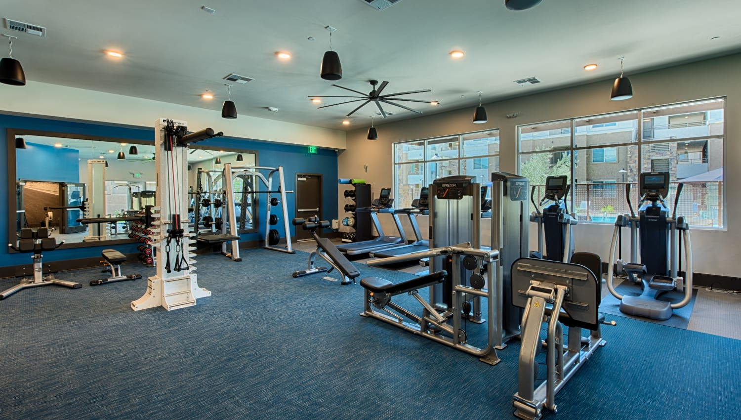Fully equipped fitness center at Ocio Plaza Del Rio in Peoria, Arizona