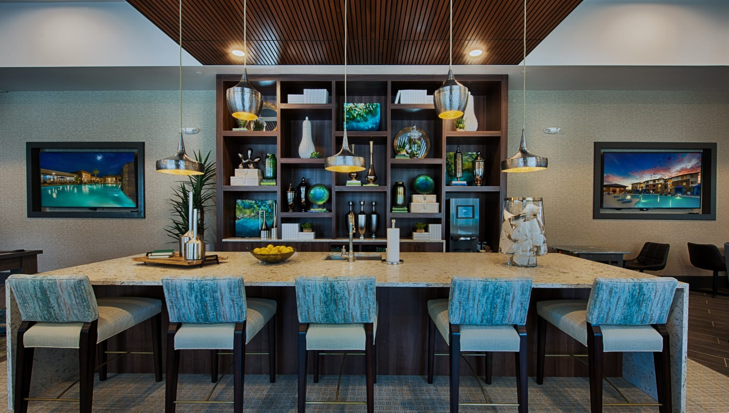 Community kitchen island at Ocio Plaza Del Rio in Peoria, Arizona