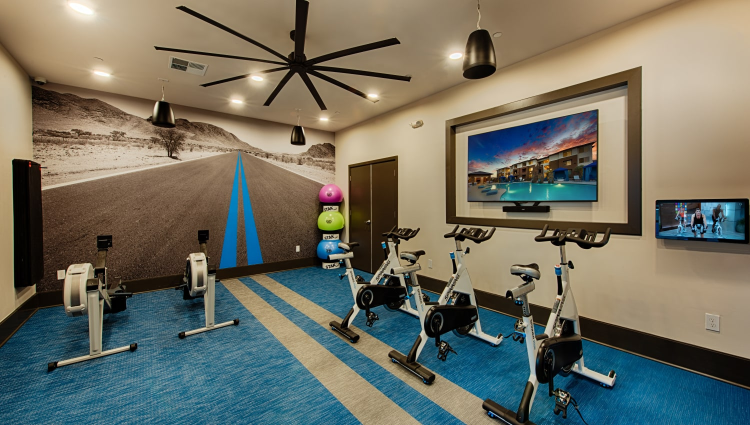 Cardio equipment in the fitness center at Ocio Plaza Del Rio in Peoria, Arizona