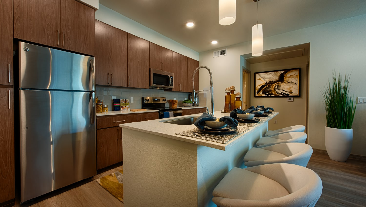 Kitchen with stainless steel appliances at Ocio Plaza Del Rio in Peoria, Arizona