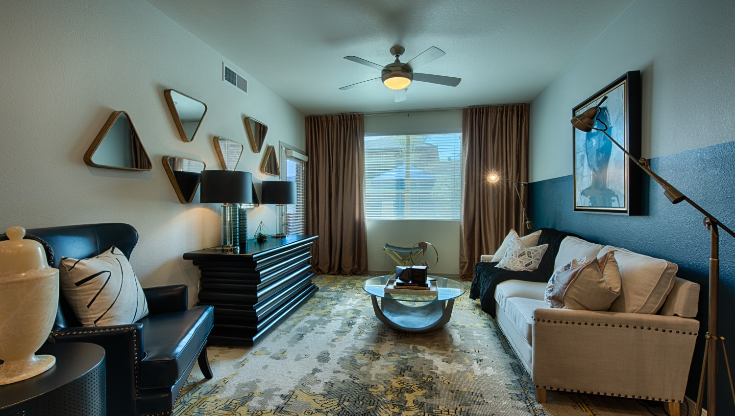 Well decorated living room at Ocio Plaza Del Rio in Peoria, Arizona