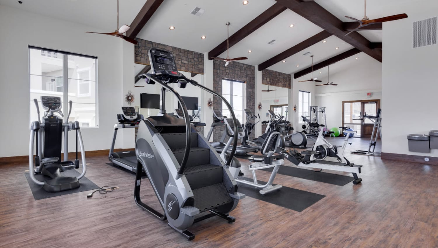 Ample equipment in the onsite fitness center at Olympus Rodeo in Santa Fe, New Mexico