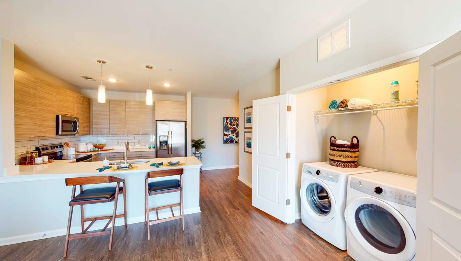 Washer and dryer by the living room and kitchen at The Palmer in Charlotte, North Carolina