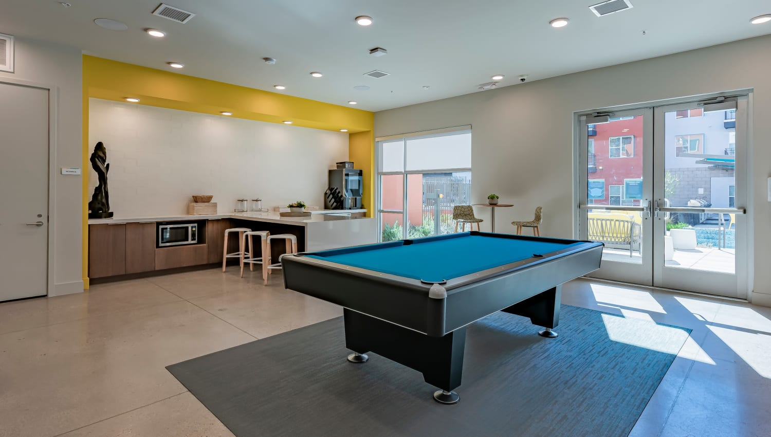 A billiards table with seating for entertaining guests at Encore Tessera in Phoenix, Arizona