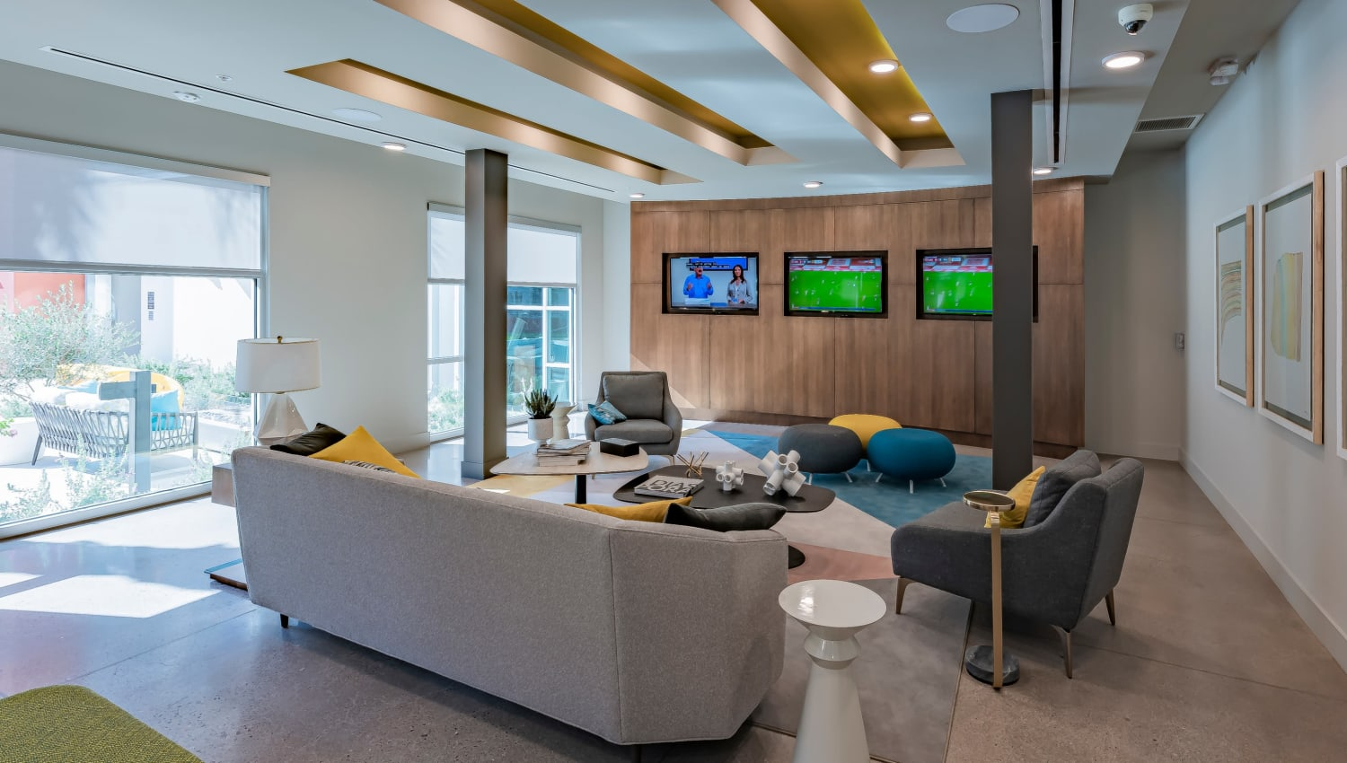 A clubhouse with three flat-screen TVs at Encore Tessera in Phoenix, Arizona