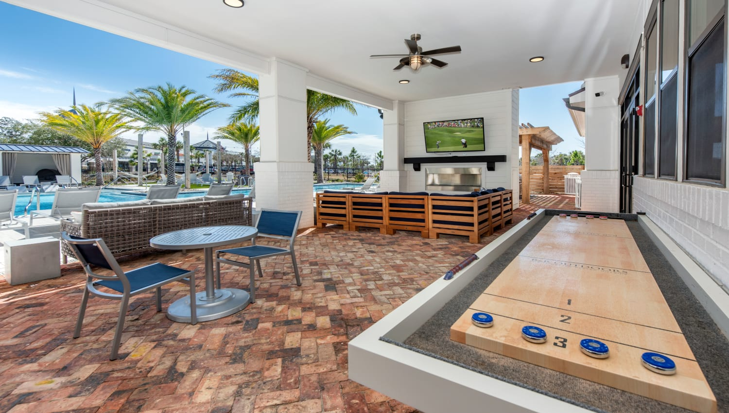 An outdoor covered game area at Olympus Emerald Coast in Destin, Florida