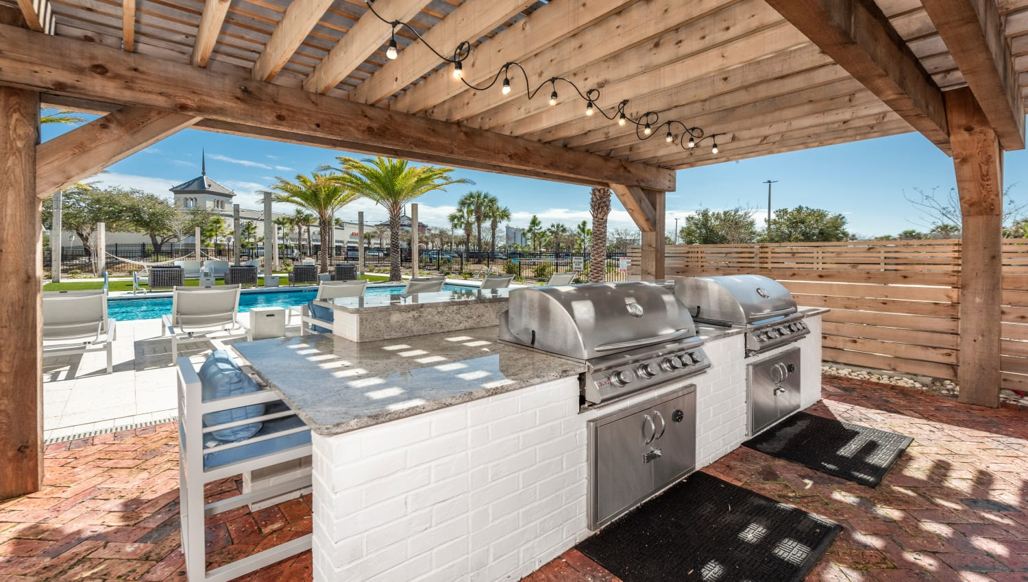 An outdoor grill with bar seating at Olympus Emerald Coast in Destin, Florida