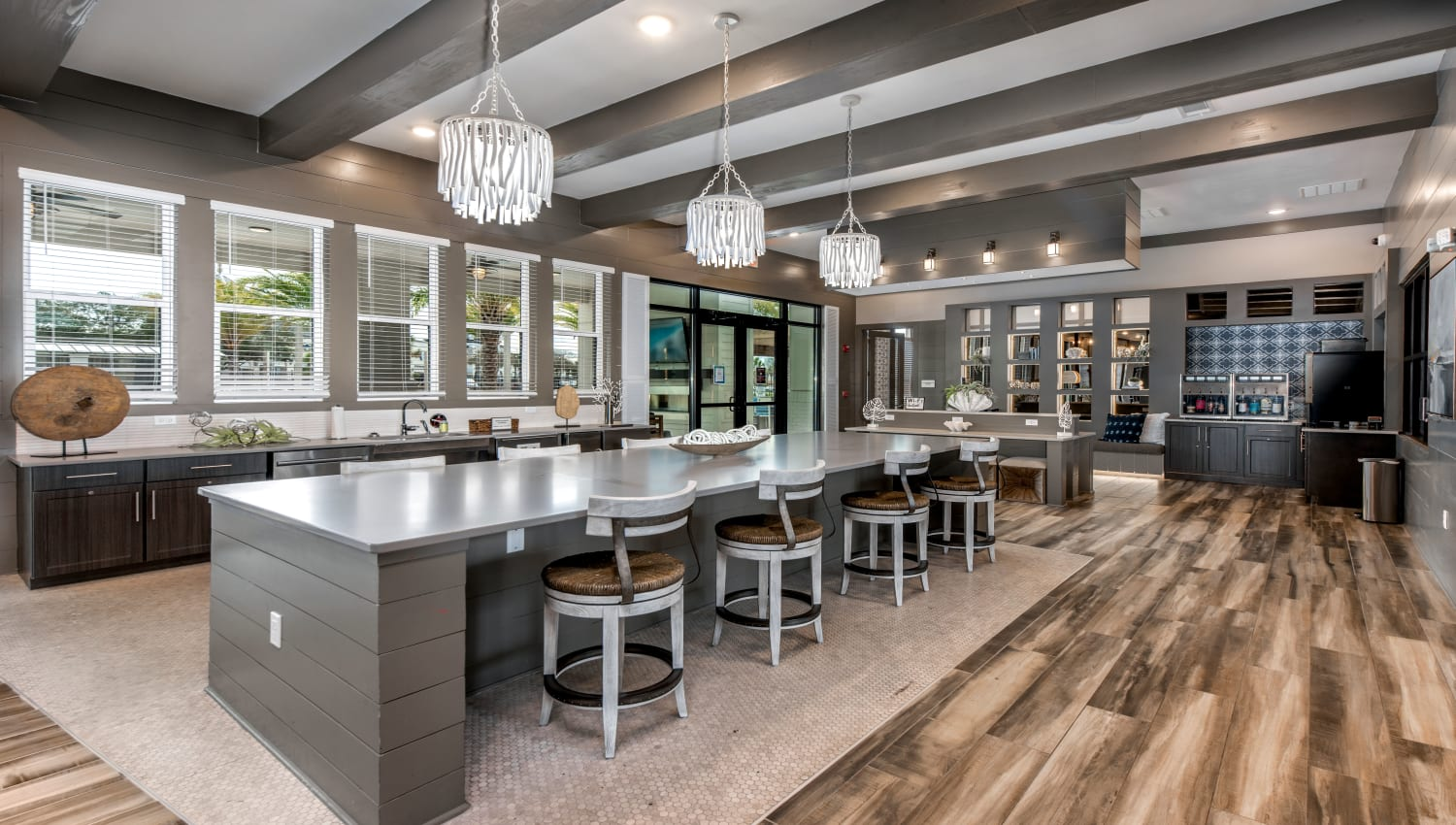 An indoor clubhouse with bar seating at Olympus Emerald Coast in Destin, Florida