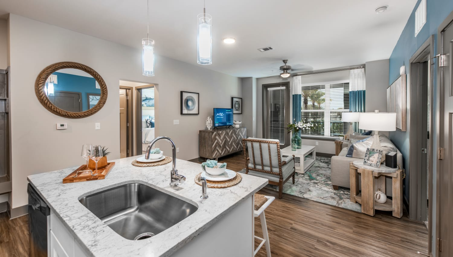 A kitchen overlooking the living room at Olympus Emerald Coast in Destin, Florida