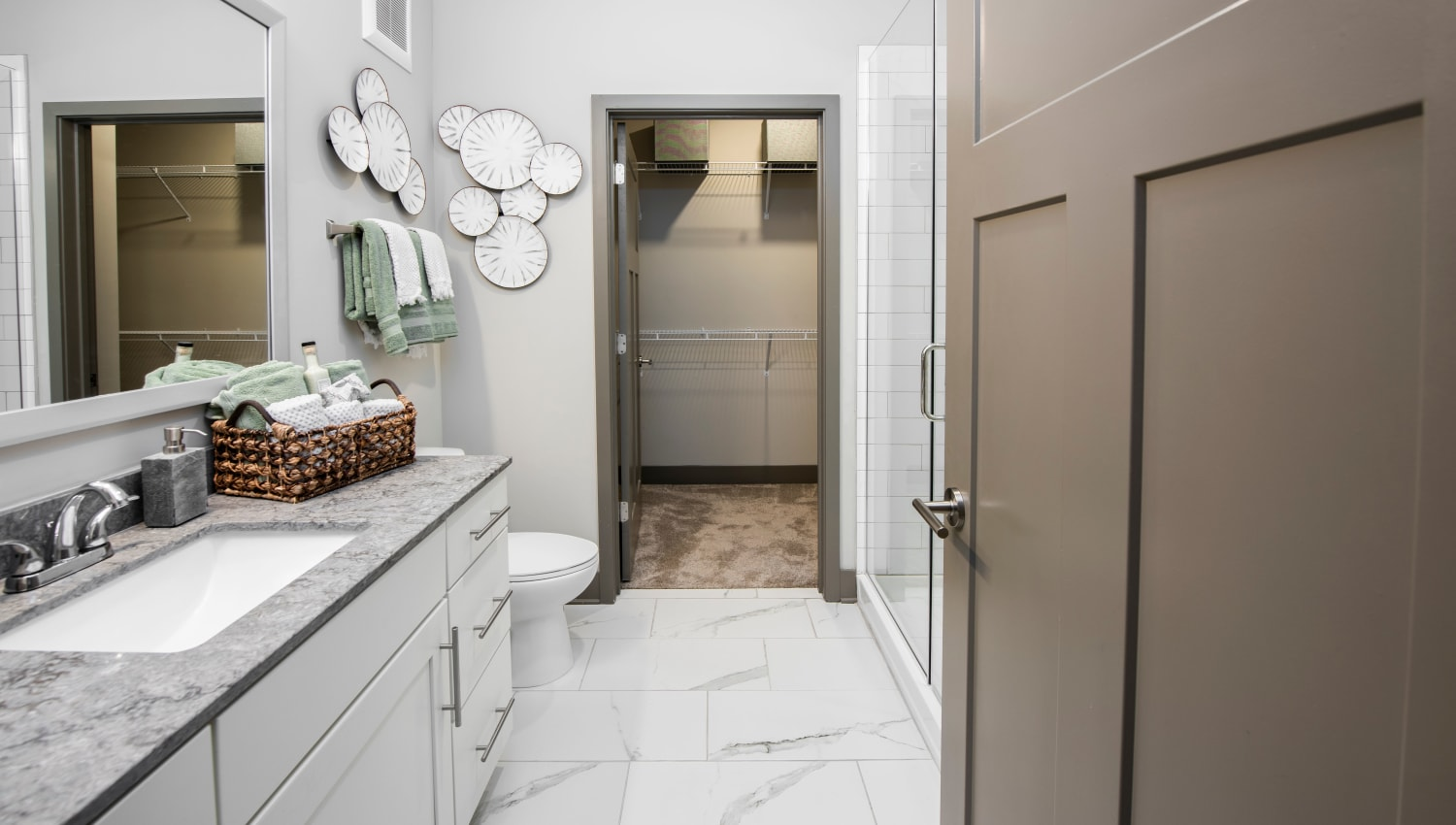 A large master bathroom with a vanity and plenty of storage at Olympus Emerald Coast in Destin, Florida