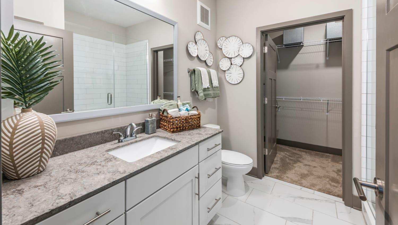 A master bathroom with a walk-in closet at Olympus Emerald Coast in Destin, Florida