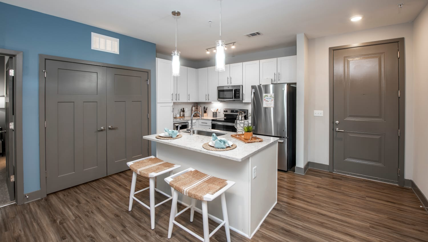 A spacious kitchen with white cabinetry at Olympus Emerald Coast in Destin, Florida