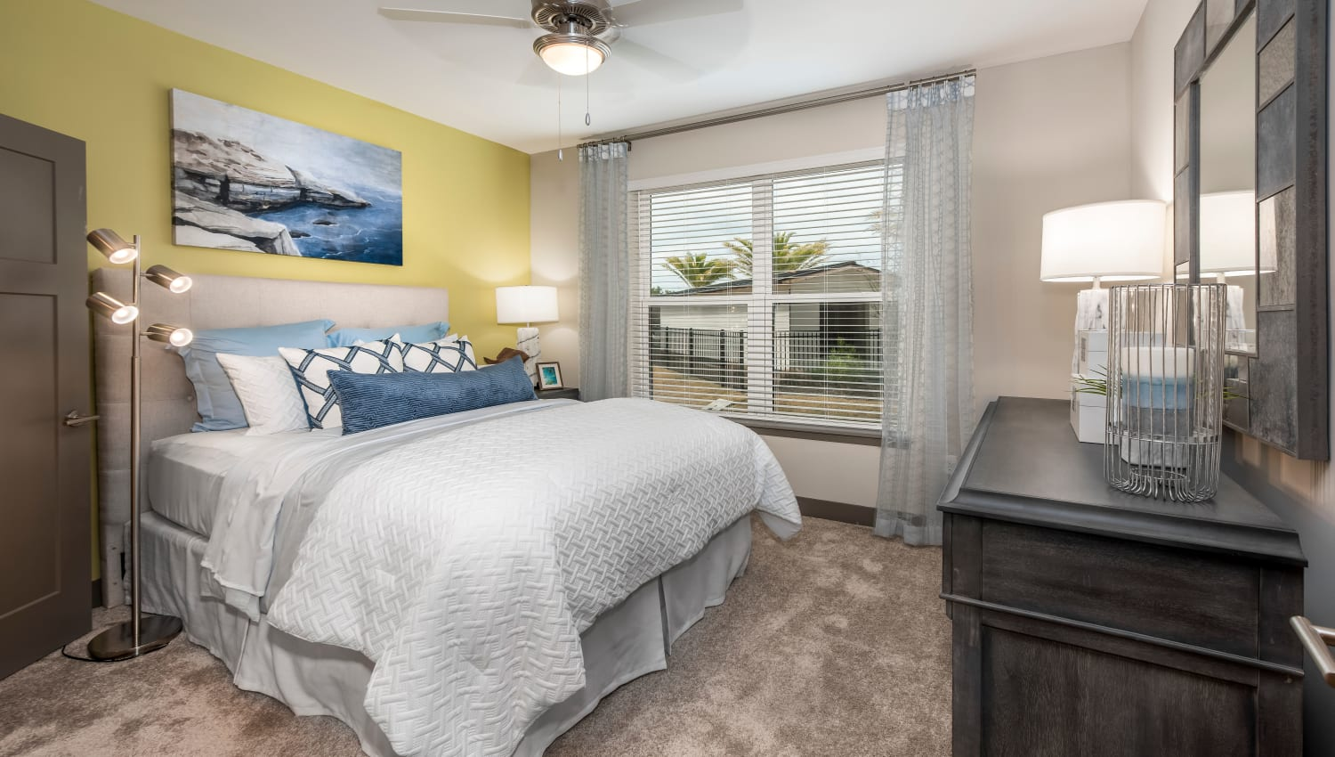 A large bedroom with plush carpeting at Olympus Emerald Coast in Destin, Florida