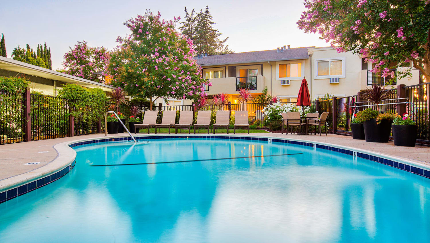 Swimming pool area on a peaceful morning at Pleasanton Place Apartment Homes in Pleasanton, California