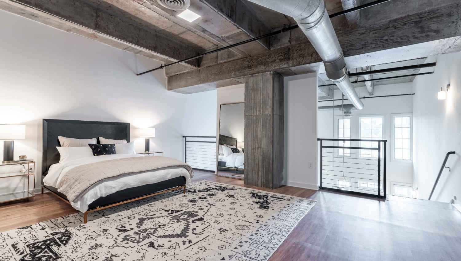Huge bedroom with tons of space for activities at 17th Street Lofts in Atlanta, Georgia