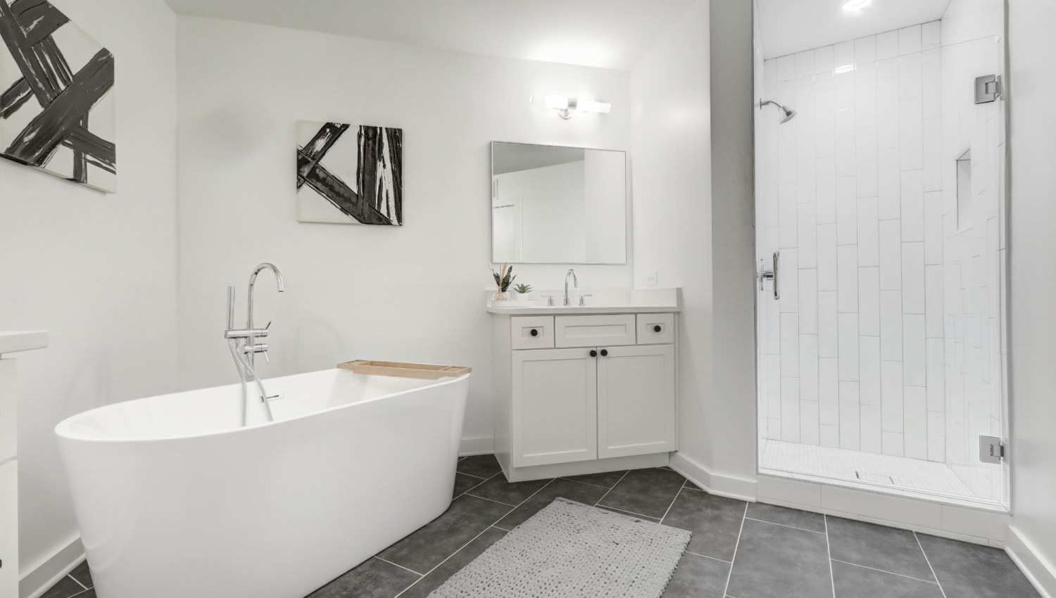 Very open bathroom with large jacuzzi style bath at 17th Street Lofts in Atlanta, Georgia