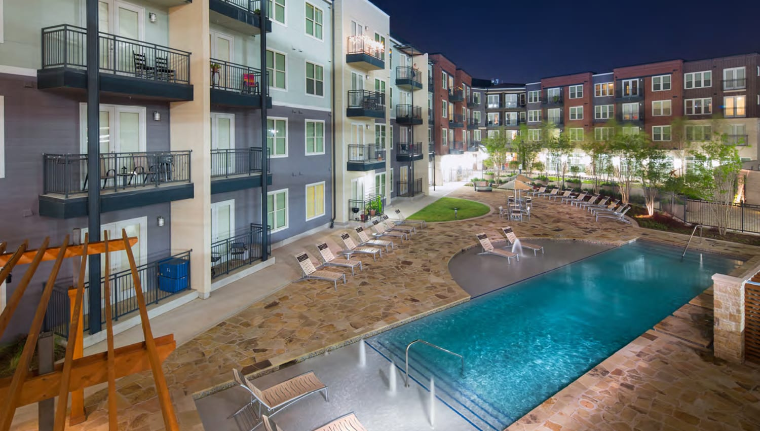 Outdoor swimming pool under the stars at Union At Carrollton Square in Carrollton, Texas