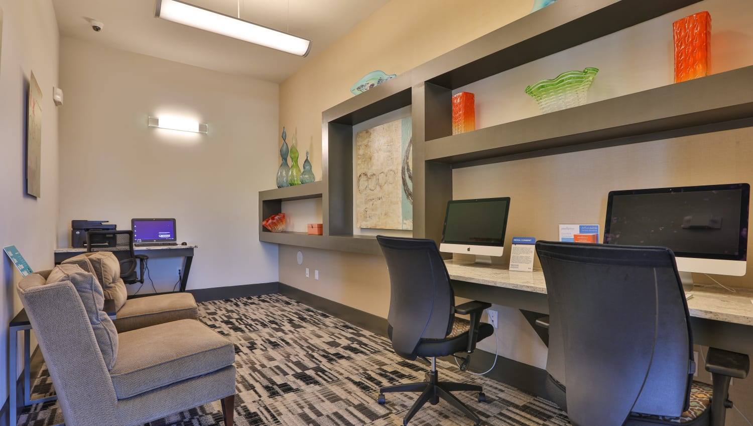 Business center with ample space at Olympus at Waterside Estates in Richmond, Texas