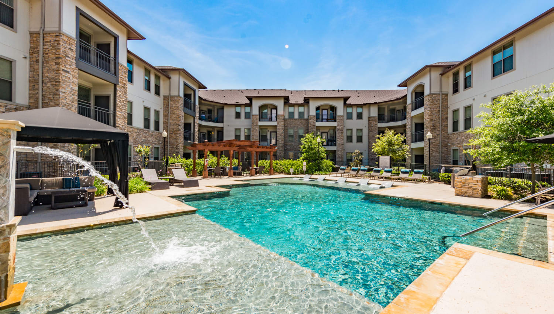 Beautiful blue pool at Olympus at Waterside Estates in Richmond, Texas