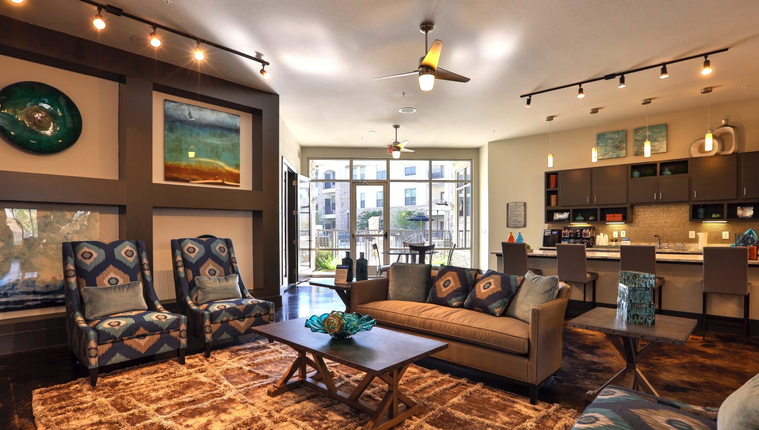 Lounging area with comfortable seating at Olympus at Waterside Estates in Richmond, Texas