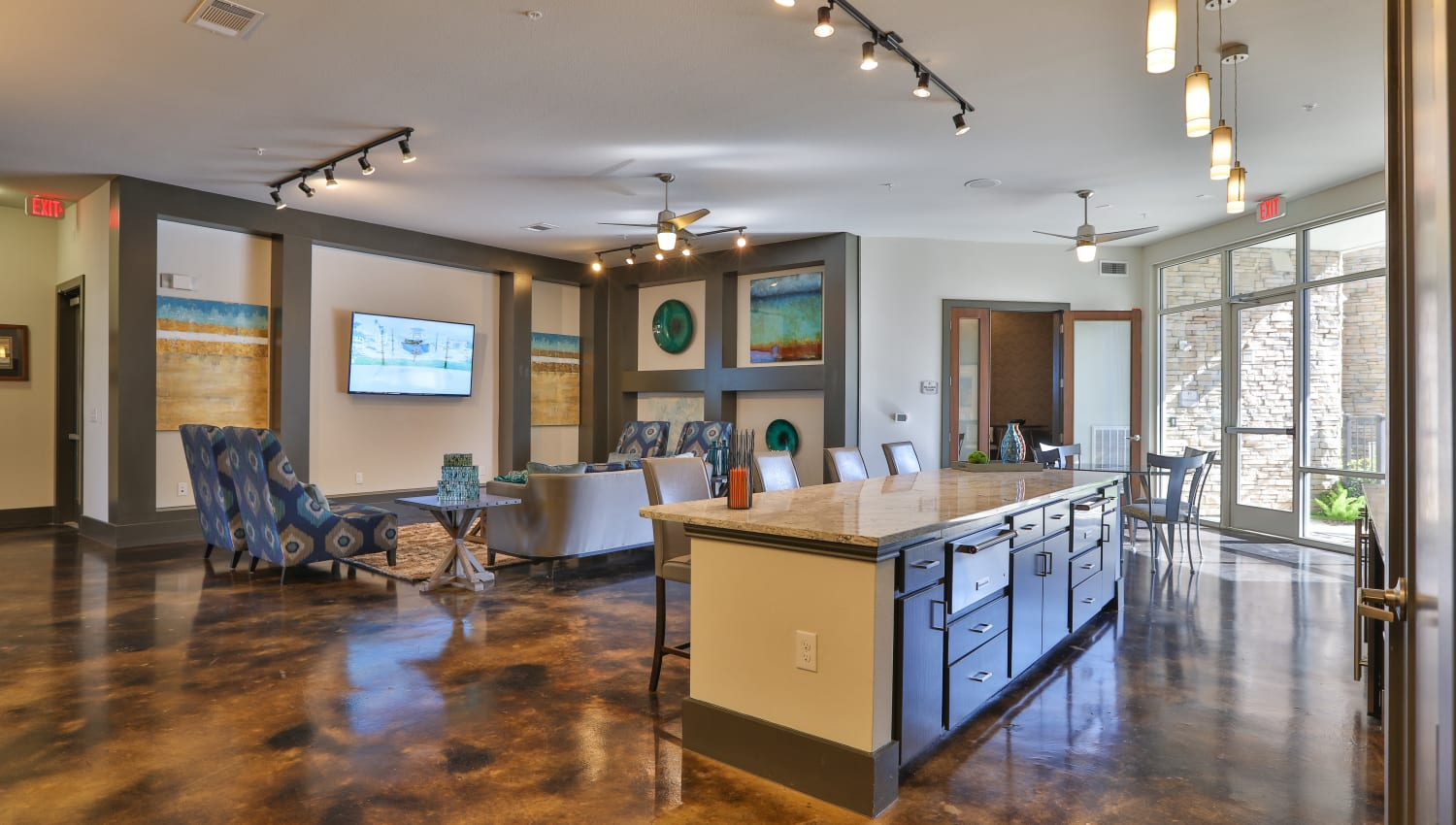 Lounge area and community kitchen area at Olympus at Waterside Estates in Richmond, Texas