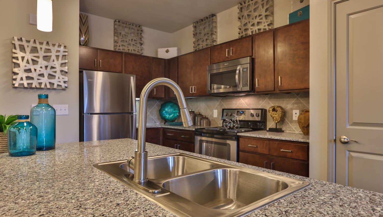 Kitchen sink in model kitchen at Olympus at Waterside Estates in Richmond, Texas