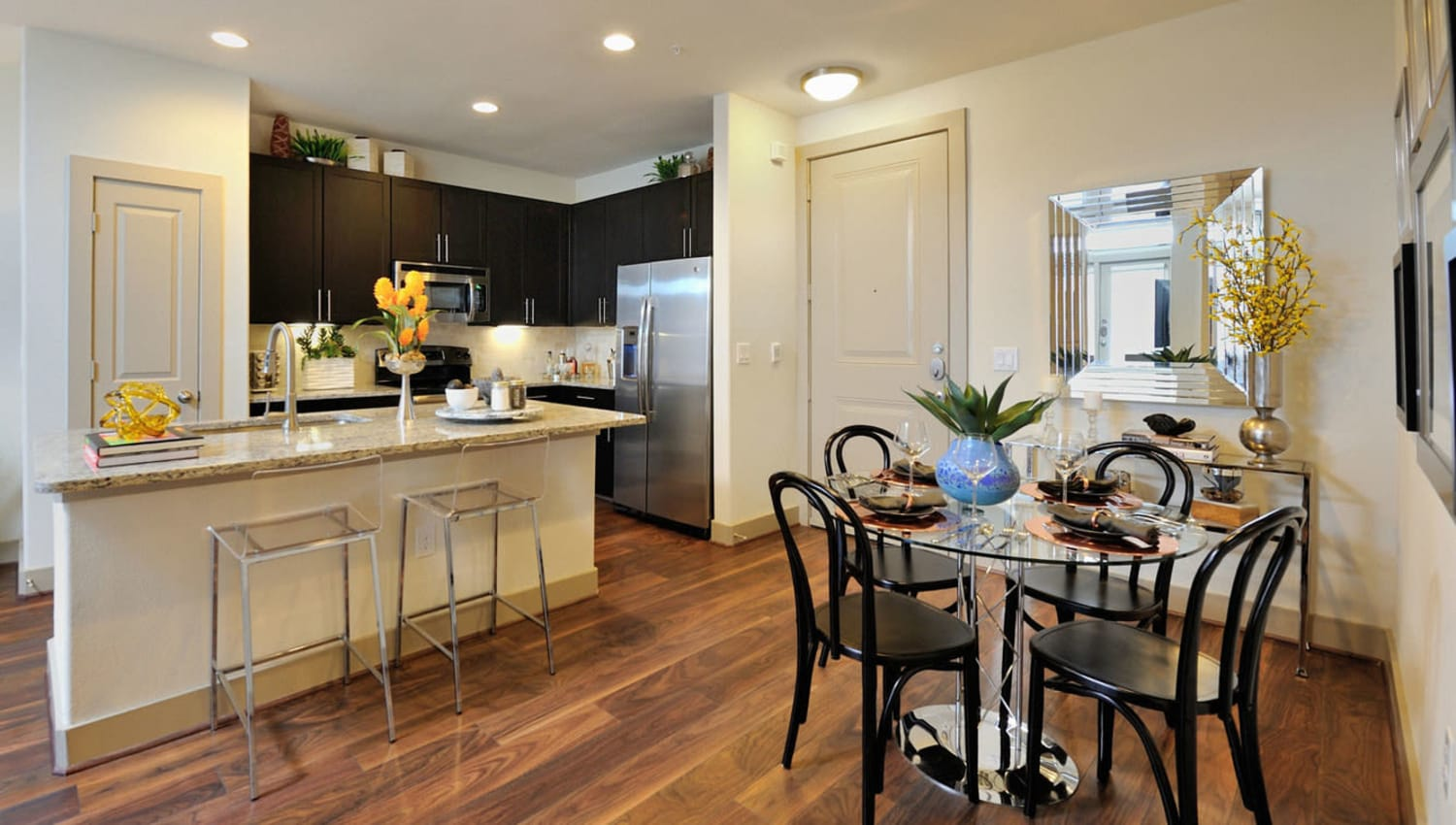 Dining table and kitchen area at Olympus Falcon Landing in Katy, Texas