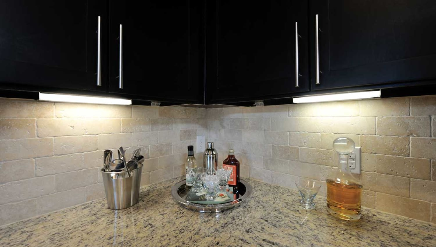 Granite counter tops and dark wood cabinets at Olympus Falcon Landing in Katy, Texas