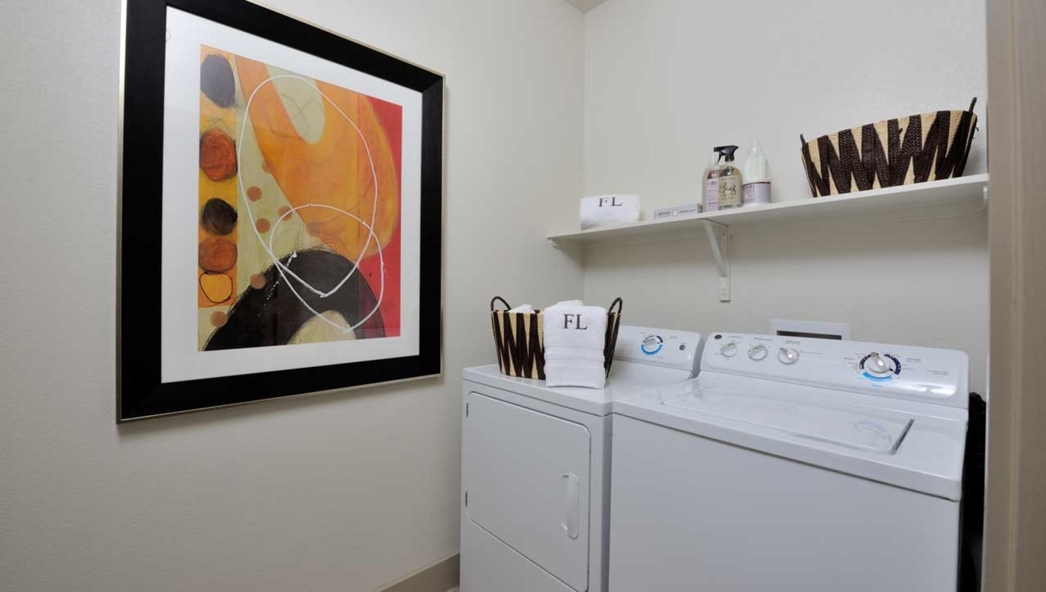 Full size washer and dryer in laundry room at Olympus Falcon Landing in Katy, Texas