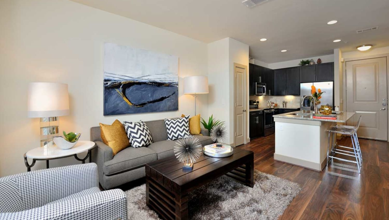 Model living room and kitchen areas at Olympus Falcon Landing in Katy, Texas
