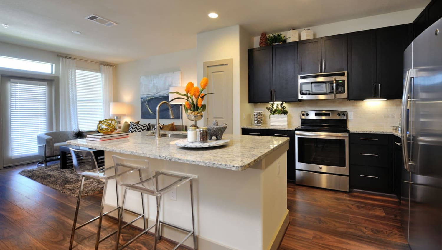 Kitchen and living room at Olympus Falcon Landing in Katy, Texas