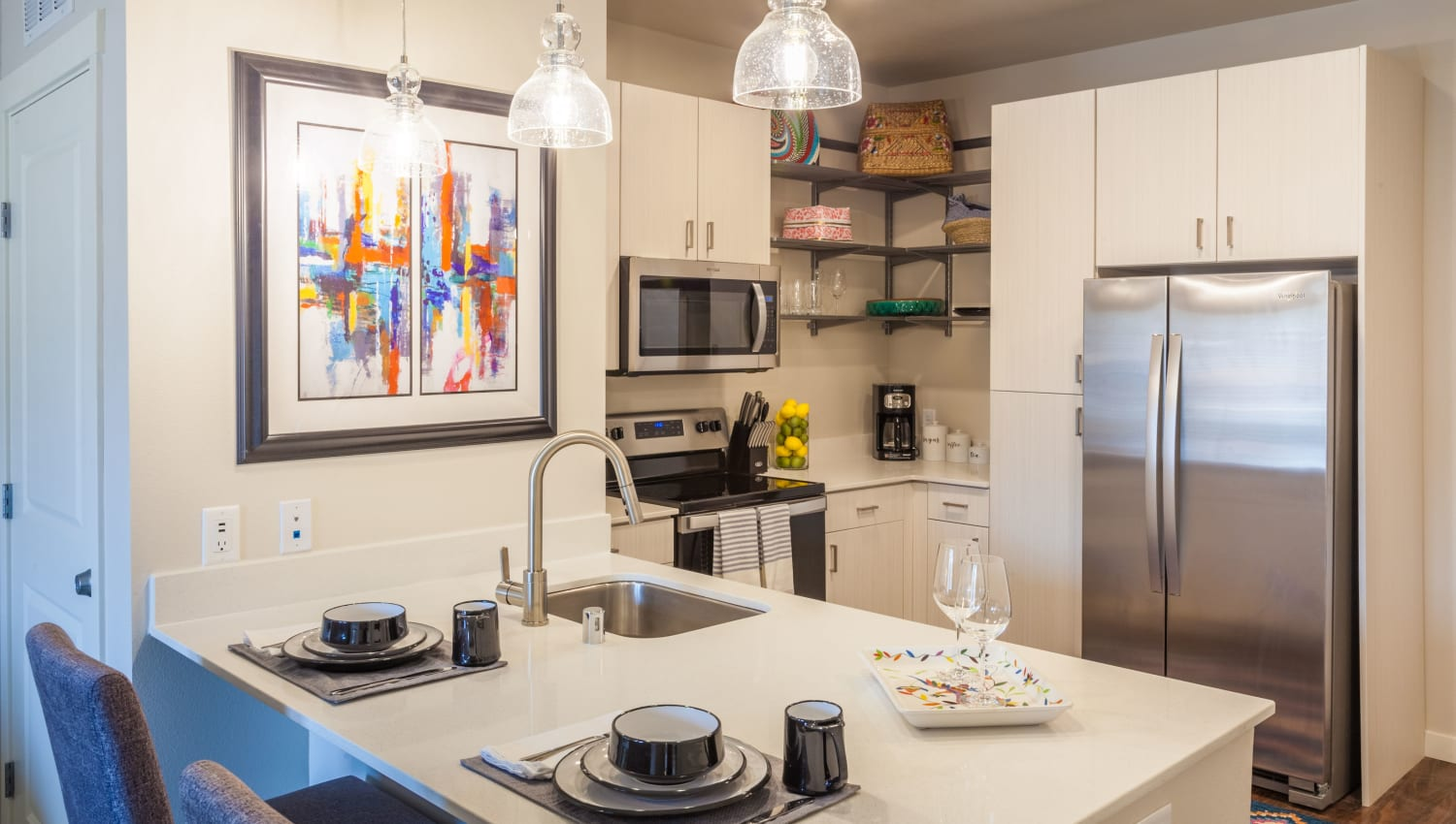 Model kitchen with stainless-steel appliances at Capitol Flats in Santa Fe, New Mexico