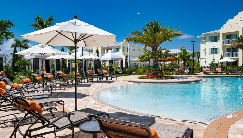 Zero-entry heated pool and lounge seating at Town Lantana in Lantana, Florida