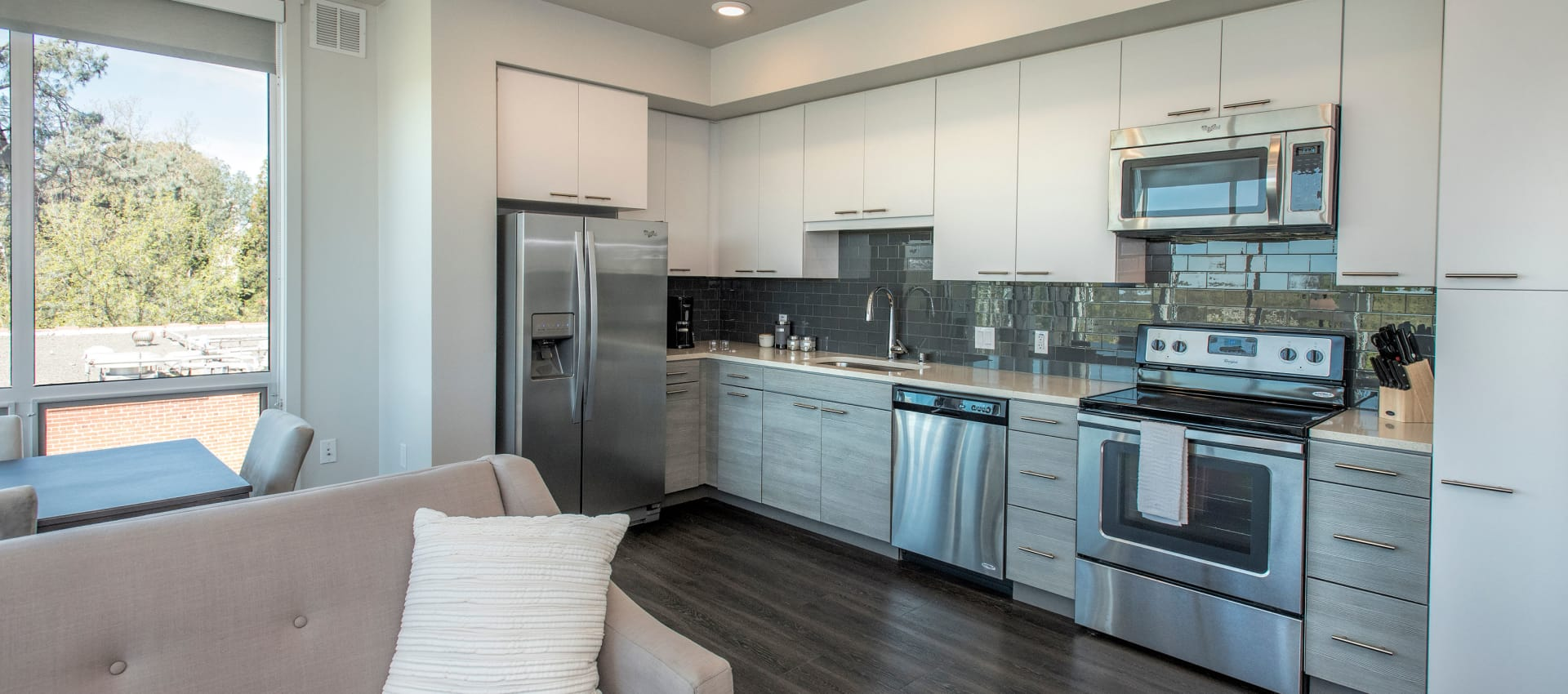 State-of-the-art kitchen with white cabinetry at EVIVA Midtown in Sacramento, California