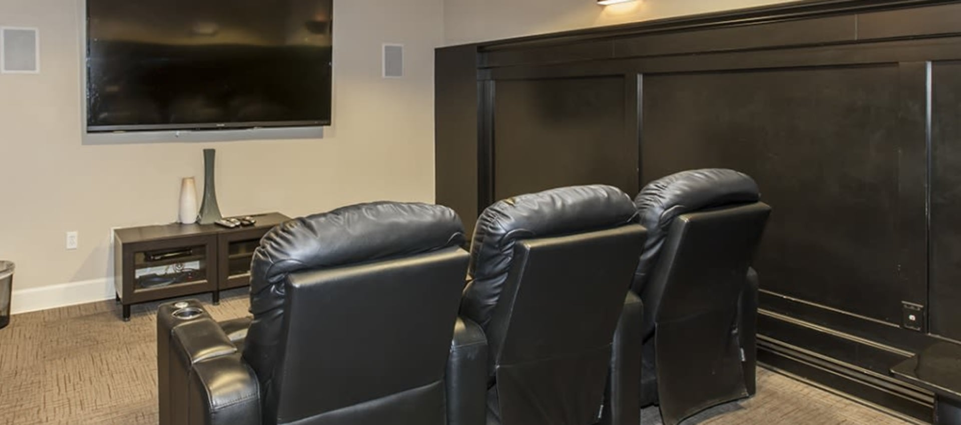 Theater room with recliners at Park Central in Concord, California