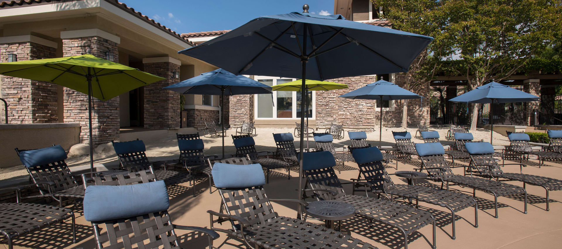 Lounge chairs pool side at Aliso Viejo apartments