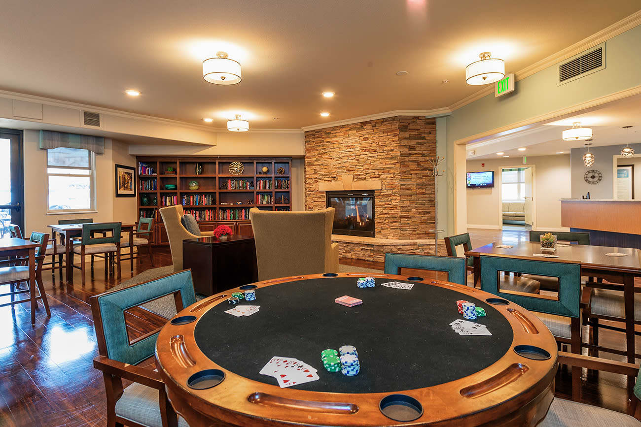 Lounge area with games and a library at The Palisades at Broadmoor Park