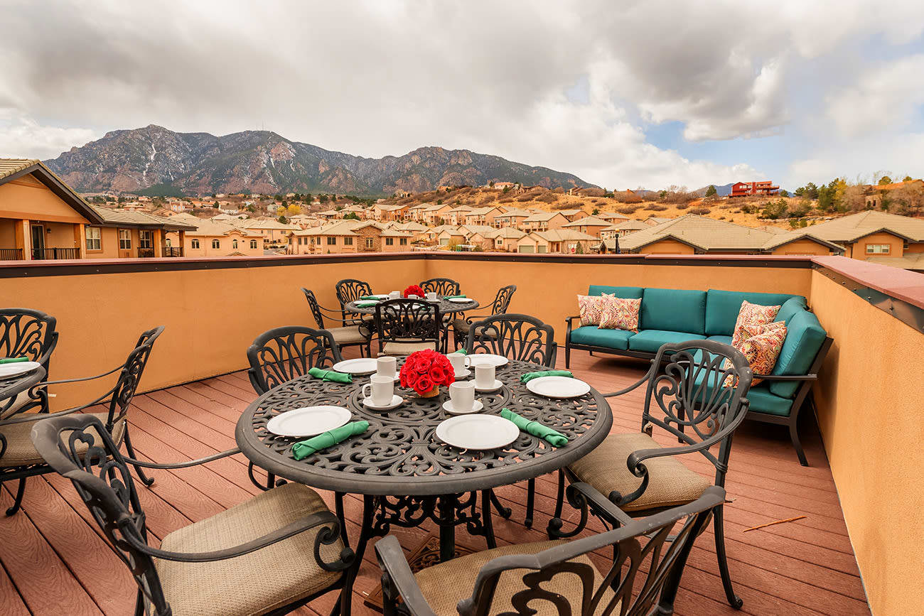 A patio at The Palisades at Broadmoor Park with a pretty Colorado view