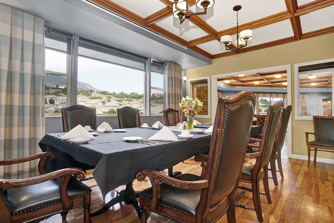 A dining area with a view at The Palisades at Broadmoor Park