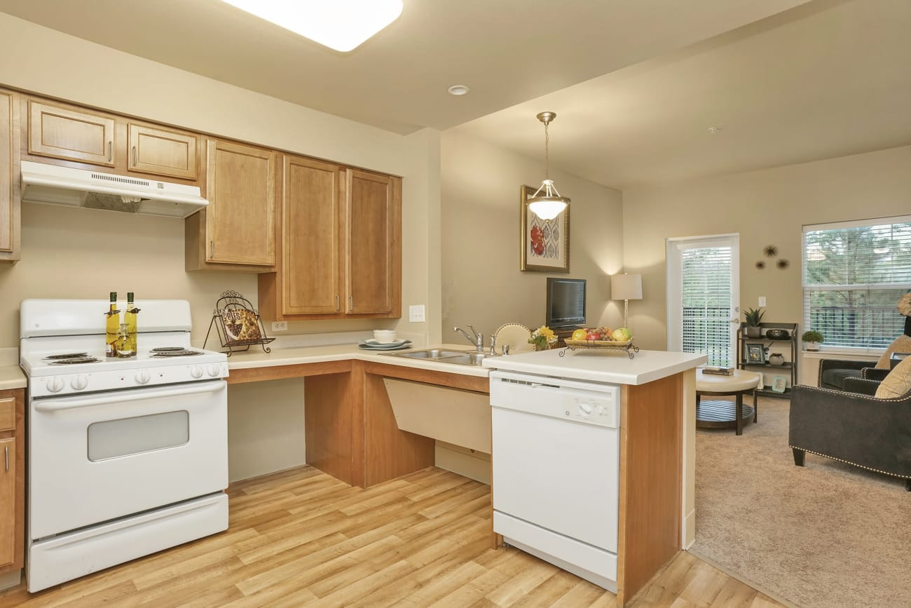A view of the kitchen and living room in an apartment at The Inn at Greenwood Village