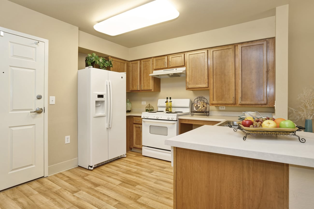 A model kitchen at The Inn at Greenwood Village with white appliances