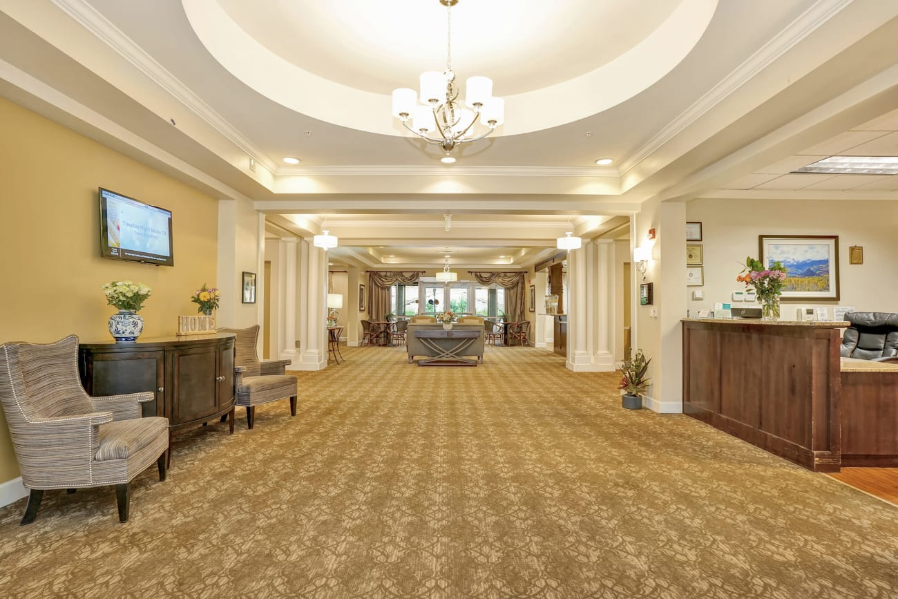 The hallway and front service desk at The Inn at Greenwood Village